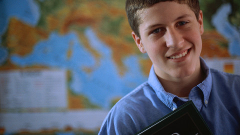 Adolescent Boy Holding a Textbook ca. 2000