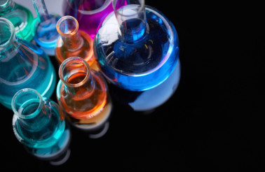 Image of several flasks with multi-color chemical liquids